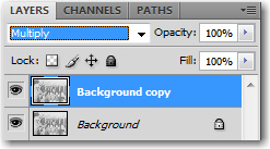 Choose Multiply from the blending modes list on the top row of the Layers panel.